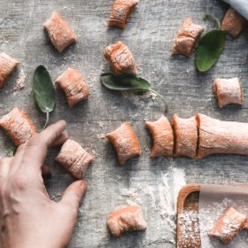 Healthy sweet potato gnocchi in the making with sage leaves