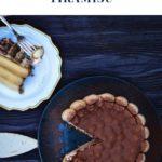 overhead shot tiramisu cake on a blue plate with an extra cake slice on a white plate