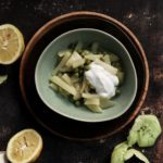 Kohlrabi and peas with coconut milk and ginger on a green plate