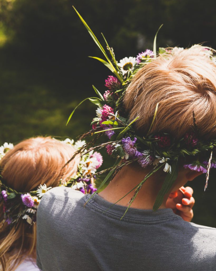 two kids with flower crowns