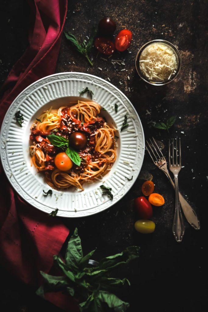 easy italian bolognese sauce with pasta on a white plate