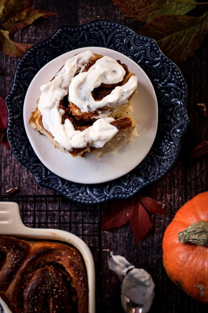 Cinnamon brioche roll on a white plate, brioche dough recipes, fall baking recipes, pumpkin recipes