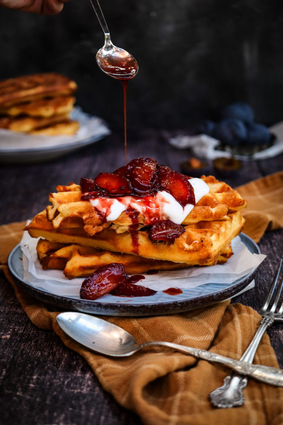 Waffles topped with roasted balsamic plums ; easy homemade waffles recipe, breakfast ideas , homemade waffles , brunch recipe