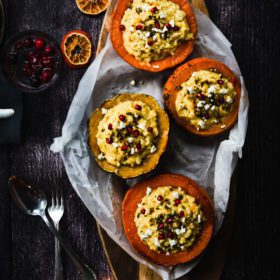 pumpkin risotto pumpkins on a wooden plate, holiday dinner ideas , vegetarian main course , christmas dinner recipes