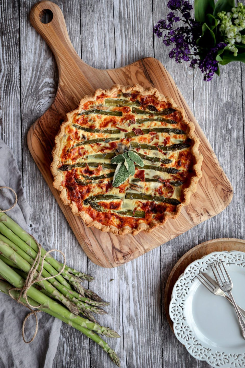 Quiche filled with asparagus, mushrooms, mozzarella and parmesan cheese