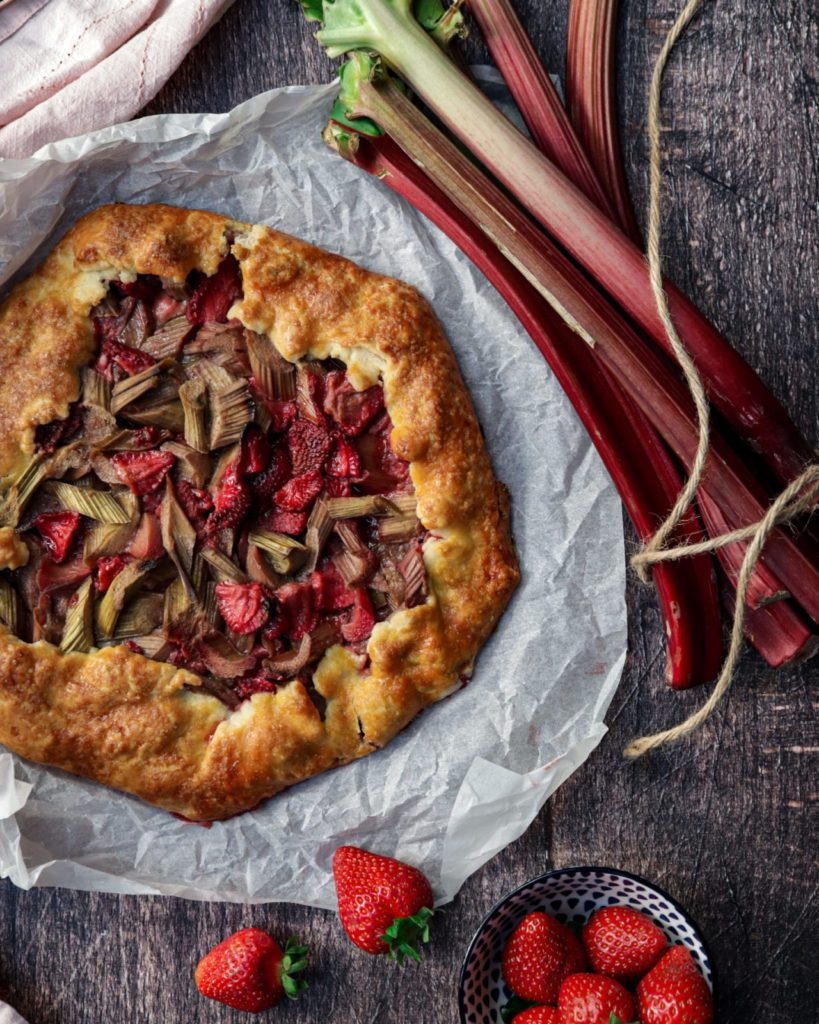 Rhubarb Strawberry Galette on parchment paper